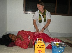 Diane treating a Newari woman