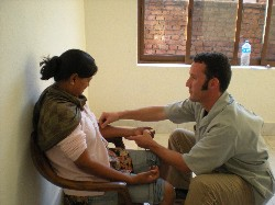Garret treating a Nepali woman