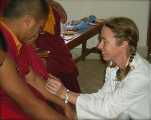 Heidi Treating Monks in Nepal