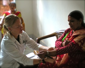 Nikole treting in Nepal Clinic